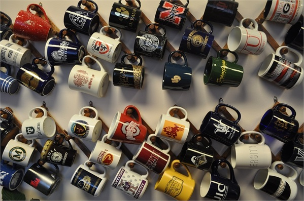 The college mug wall in the Lighthouse College Planning lobby